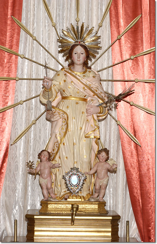 A wooden statue, the gift of the Cardinal-Archbishop of Naples