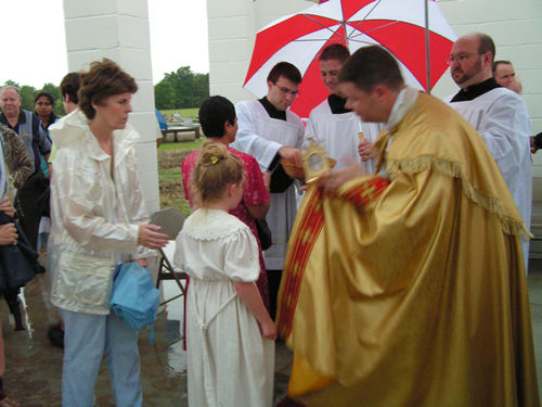Father Partain, offers veneration of First Class Relic of Saint Philomena at the new Shrine in Mansura, Louisiana, United States, August Feast Day, 2008