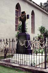 Saint Joseph Damien de Veuster of Molokai grave site next to the his Saint Philomena Church.