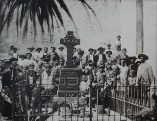 Saint Joseph Damien de Veuster of Molokai surrounded by his flock.
