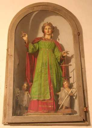 A very old statue of the church of the <a href=