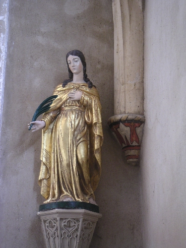 A lovely statue on the church of Montanay, France.