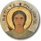 Saint Clement Church.  Images of eight women saints (including this one of Saint Philomena) appear in mosaics with a golden background on the piers that uphold the dome.