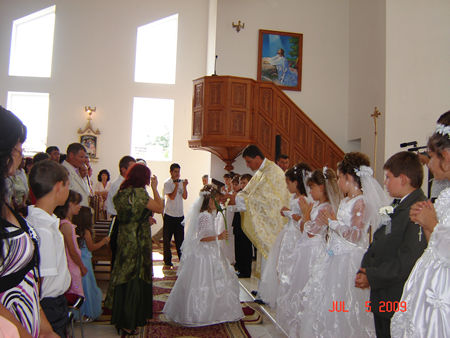 One by one the young girls and boys are invited by priest at Altar to be received and blessed.