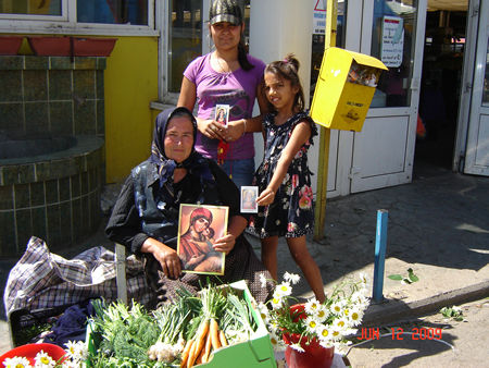 Poor people selling vegetables are happy to receive St. Philomena in their lifes. Thank you Patti.