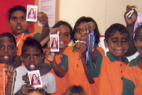 Children with Fr. Daniel Kilala AUSTRALIA