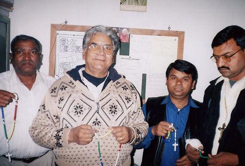 Father Thomas Gulfam with staff.