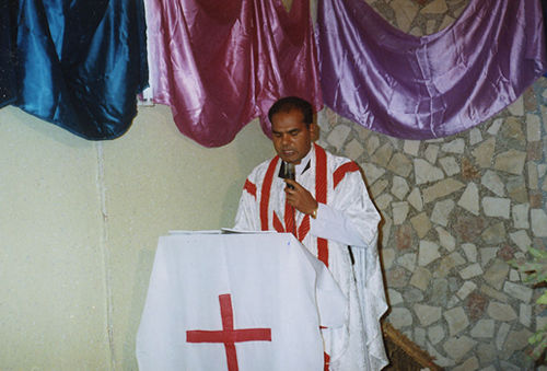 Father Younis Riaz giving lecture.