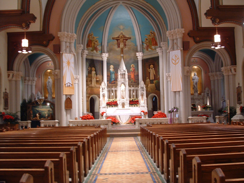 This is the picture of the front of St Philomena's Church in Lansdowne, PA - capturing the main altar & the two side altars (Mary's on the left and St Philomena's on the right. Also, if you look closely at the mural painted behind the main altar - St Philomena is to the left of the center crucifixion depiction & St John Vianney is to the right of the center crucifixion depiction. St John Vianney is painted standing outside his confessional pointing over to St Philomena.