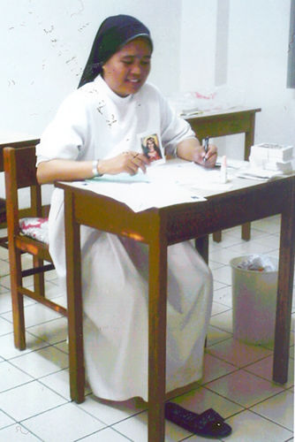 Sr. Eljisa prepares the membership cards for the pupils of the Pledge of Love School and welcomes them into the ULRA Family. The Local Superior of the Daughters of Charity of the Most Precious Blood gladly acknowledges the Sacramentals from the Universal Living Rosary Association of Saint Philomena.