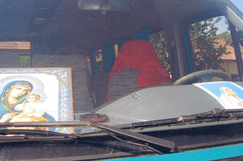 The microbus to Tihau Village was prepared. The Our Lady image was in front of the bus for protection.