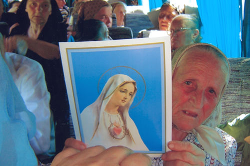 People in bus were very glad to have the Our Lady images.