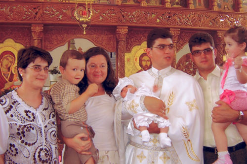 The next day was a special event for all Transylvania: it was the baptizing of the first Filomena in our country. Father Puie Ioan caring the precious baby in front of the Altar.