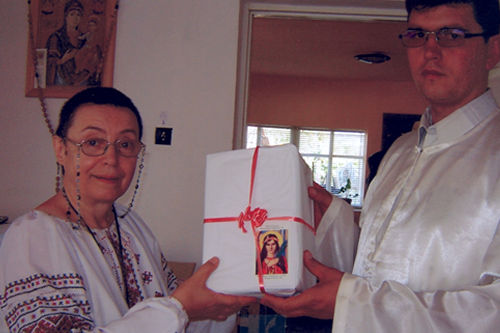 Father Ioan Puie was very happy for this special event. He was happy also to get so many presents from the ULRA.