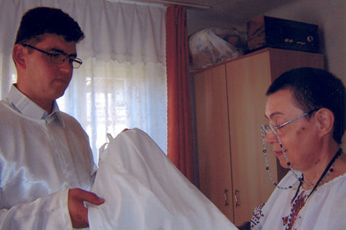 Father Ioan Puie receiving priest clothes also. He is extremely happy for this present. Thank you very much dear ULRA.