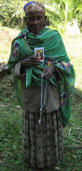 Bizunesh Busho, She was crazy before. Now with a help of God and a praying of our member of the Universal Living Rosary Association of St. Philomena praying she come full fine. We were praying by going to her house by caring ST. Philomena oil & scapular. In this process I was ahead of this group. I paint St. Philomena oil in her for head & I wear to her blue scapular & we pray in many time rosaries by asking marry to help her. After many our praying now she is fine & she be the follow of St. Philomena she be the example of for our member.