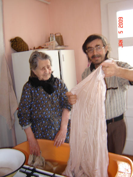 Francisc who have surgery on his intestine together with Sr. Veronica trying to wash some bed clothes. But they can not. So I helped them. Even for me was very difficult at my 65 years old. Because there is no electricity, no washing machine.