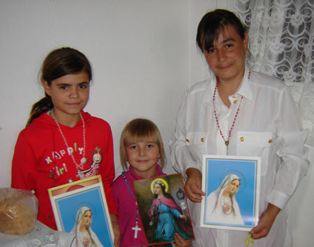 """The little Carina have a special message for you: """"Dear Patti please send us some more rosaries, Holy Medals, Holy Images, all you can for our Protestant friends .They think they are Protestants but in fact they never pray, never go at Church. And they are happy to pray <a href="""