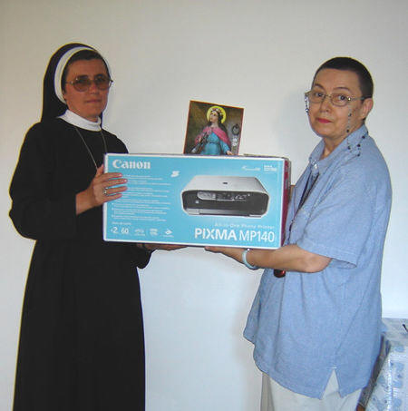 "Sr. Marcela receiving a copy machine for their convent, so much necessary in spreading the Faith. ""Thank you very much dear ULRA Family. We always pray for you. God bless you all!!!"""