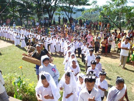 First Communicants are brought to the Church with Traditional Welcome Dance