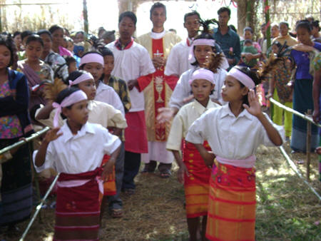 The priest is welcomed to the Alter with traditional dance during a Village Mass